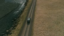 aerial view over an SUV traveling on a dirt road