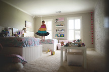 girls playing with legos in a bedroom