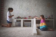 girl playing with legos in a playroom