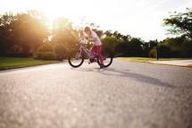 a girl child riding a bike