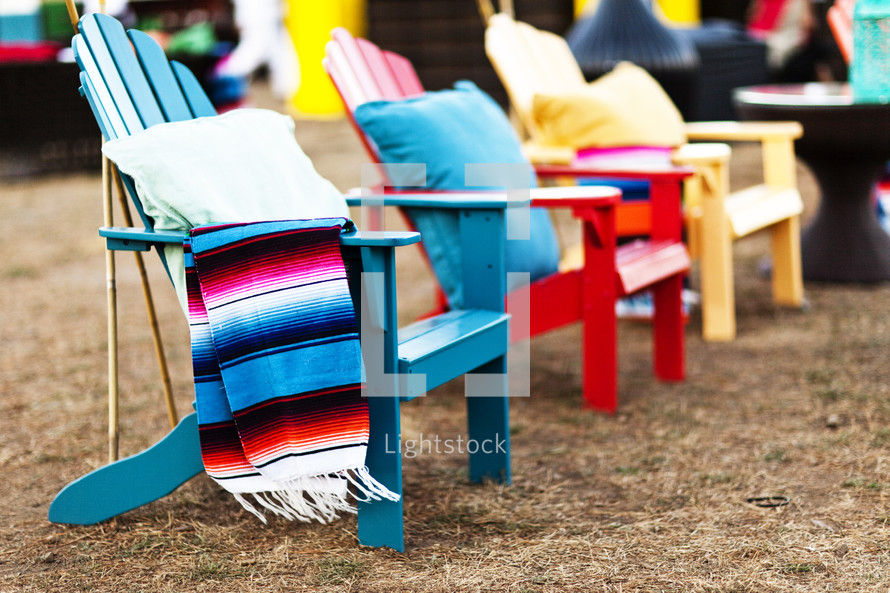 colorful Adirondack chair beach red blue yellow row