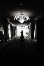 Bride walking down hallway of mirrors silhouette