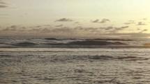 tide washing onto the shore at sunset