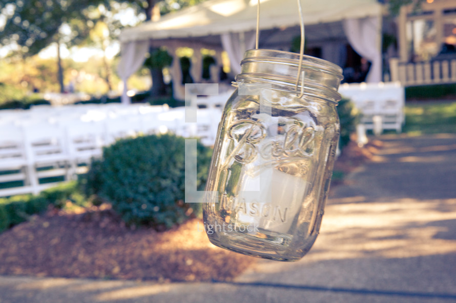 mason jar hanging outside house in the country