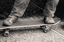feet of a boy skateboarding