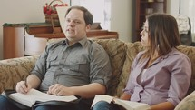 a couple in a discussion at a Bible study