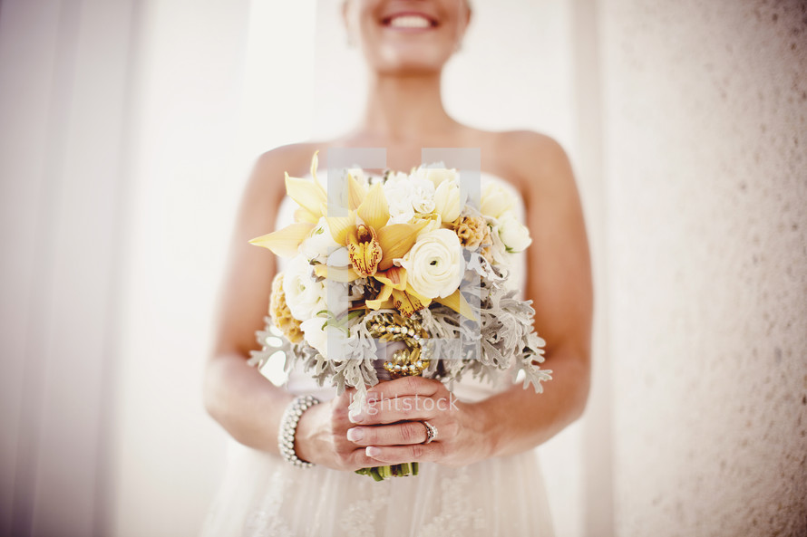 A bride shows off her bouquet