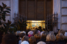 crowds of people entering a Catholic church in Rome