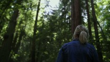 a woman exploring a forest