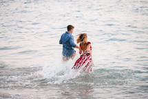 couple running into the ocean