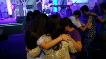group praying together at a worship service