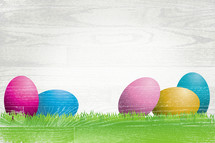 Easter Eggs and wooden texture