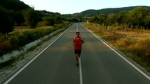 a man jogging on a road