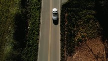 car traveling down a country road