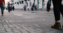 people walking through a town square in Romania
