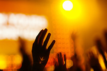 Hands raised in worship orange flare