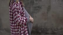 teen pregnancy, pregnant teen walking outdoors