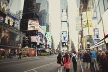 People walking around Times Square