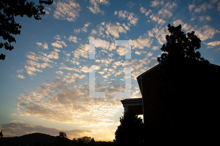 Sunset and silhouetted house