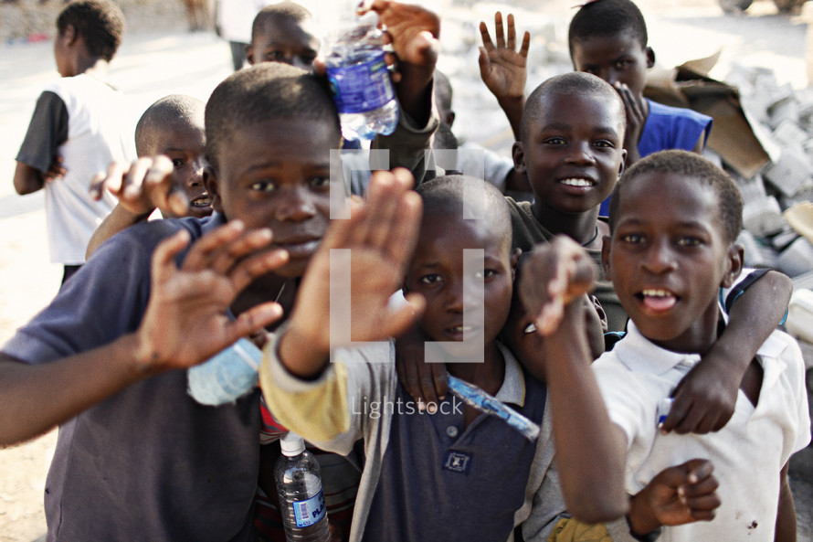 Group of children waving.