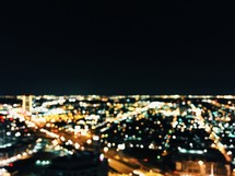 aerial view above a city at night