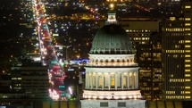 lights from passing cars at night in front of the dome of the capital building in Washington DC