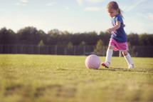 child with a soccer ball