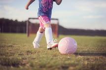 girl child playing soccer