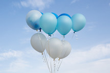 blue and white helium balloons