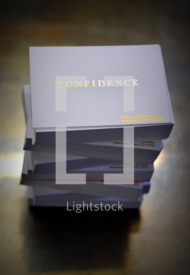 stack of business cards with the word confidence