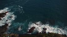 waves crashing into rocks