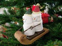 marshmallow snowman ornament on a Christmas tree