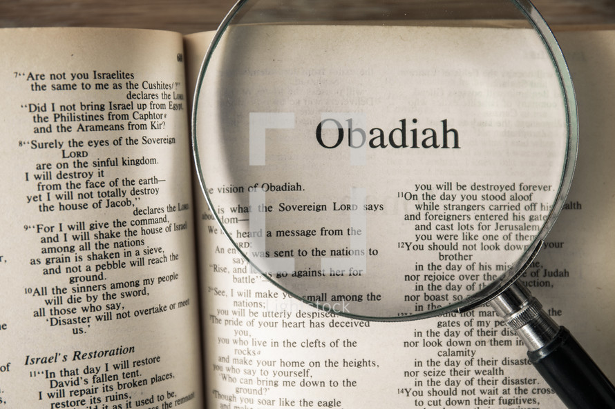 magnifying glass over Bible - Obadiah
