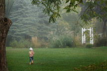 a girl running in her backyard
