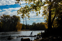 kids exploring a riverbank