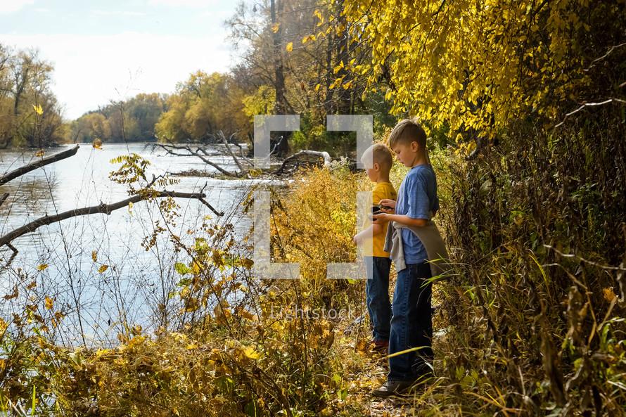 boys exploring a riverbank