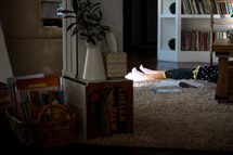 child napping on a rug