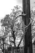 broken basketball hoop on a pole