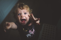 screaming reaching toddler