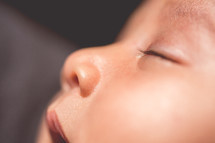 face of a sleeping newborn