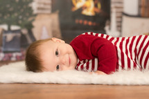 infant boy in Christmas pajamas