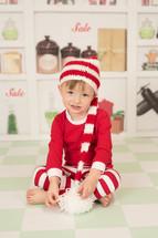 a boy in Christmas pajamas