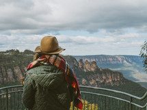 a woman looking over a viewing site in the blue mountains