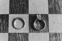 wedding rings on a checker board