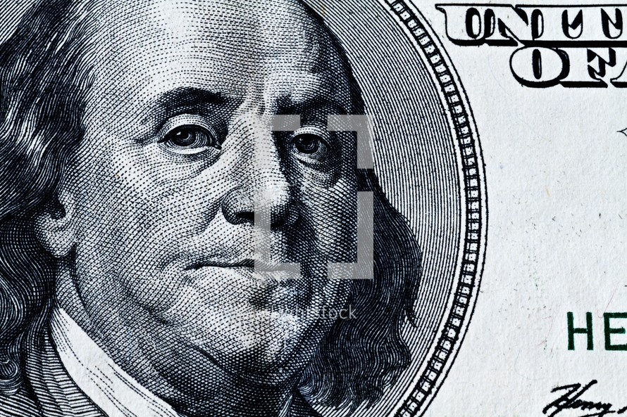 A closeup of Benjamin Franklin on a one hundred dollar bill