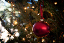 Christmas ornaments on a decorated Christmas tree.