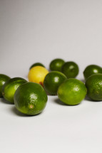 One lemon among a group of limes