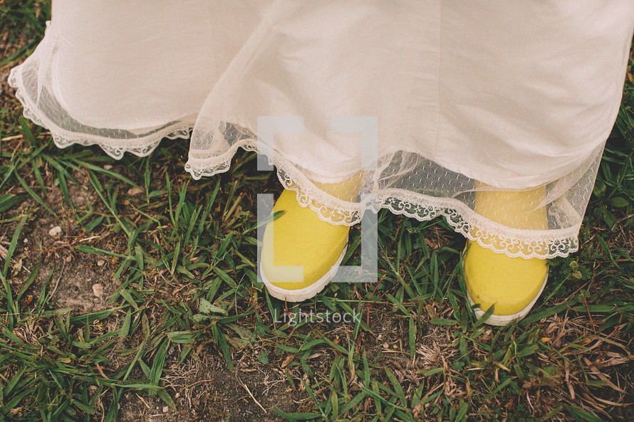Woman with white dress and yellow rain boots