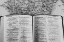 open Bible on a map of Africa, missions preparation
