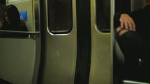 riding on a subway train